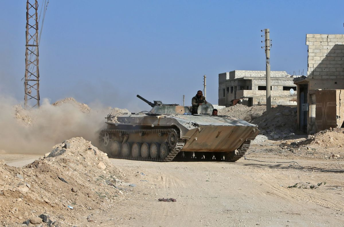 A Syrian army APC rolls in the former rebel-held area of Beit Nayem in the Eastern Ghouta region on the outskirts of the capital Damascus.
