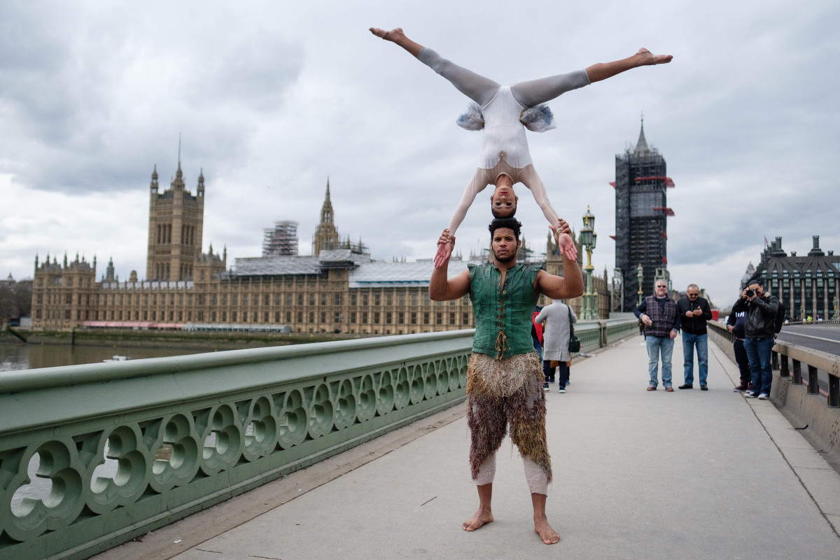 Circus artists perform on Westminster Bridge to mark the 250th anniversary of the modern-day circus ahead of a reception in the Houses of Parliament on March 6th, 2018, in London, England.