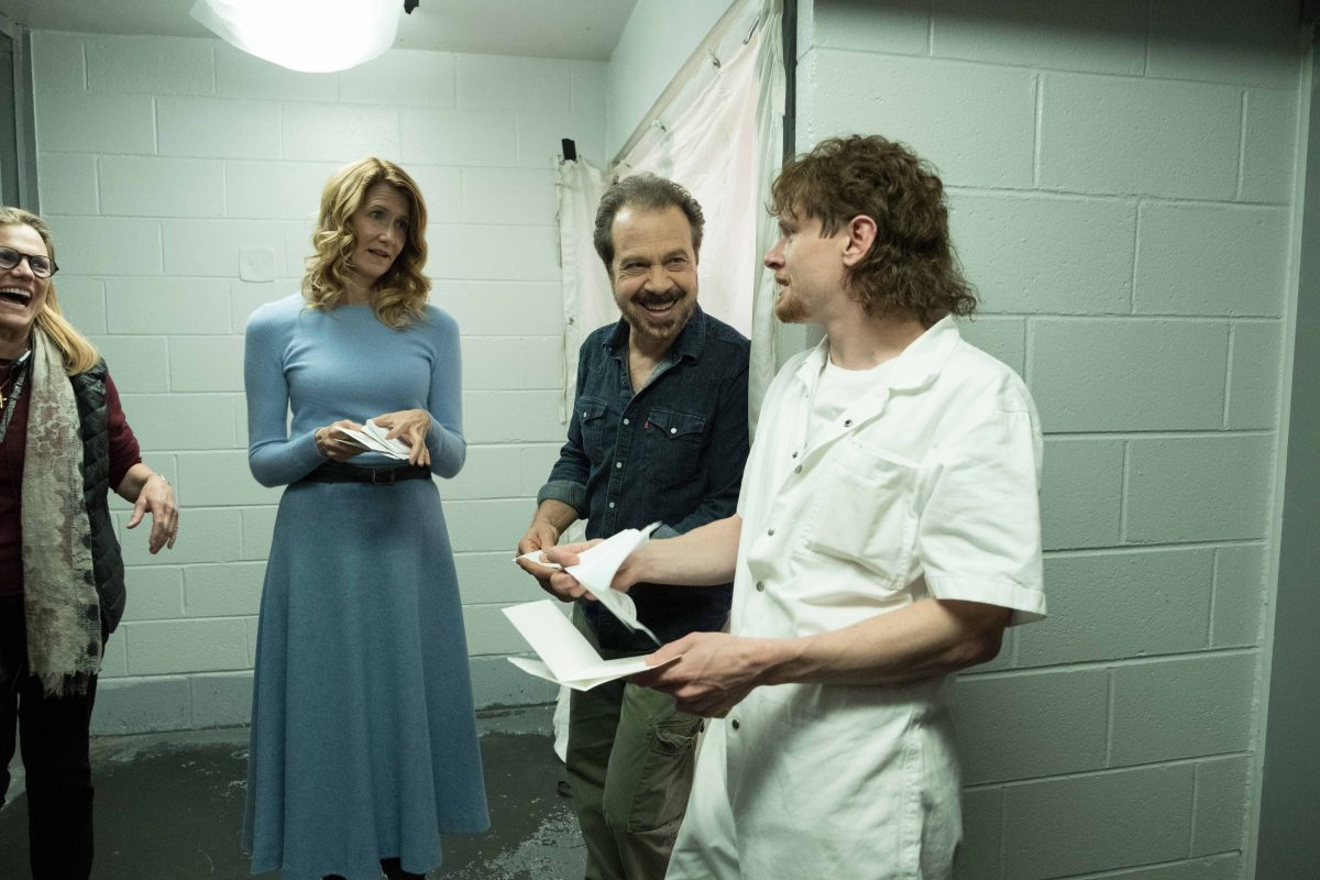 Laura Dern, Edward Zwick, and Jack O'Connell on the set of Trial by Fire.