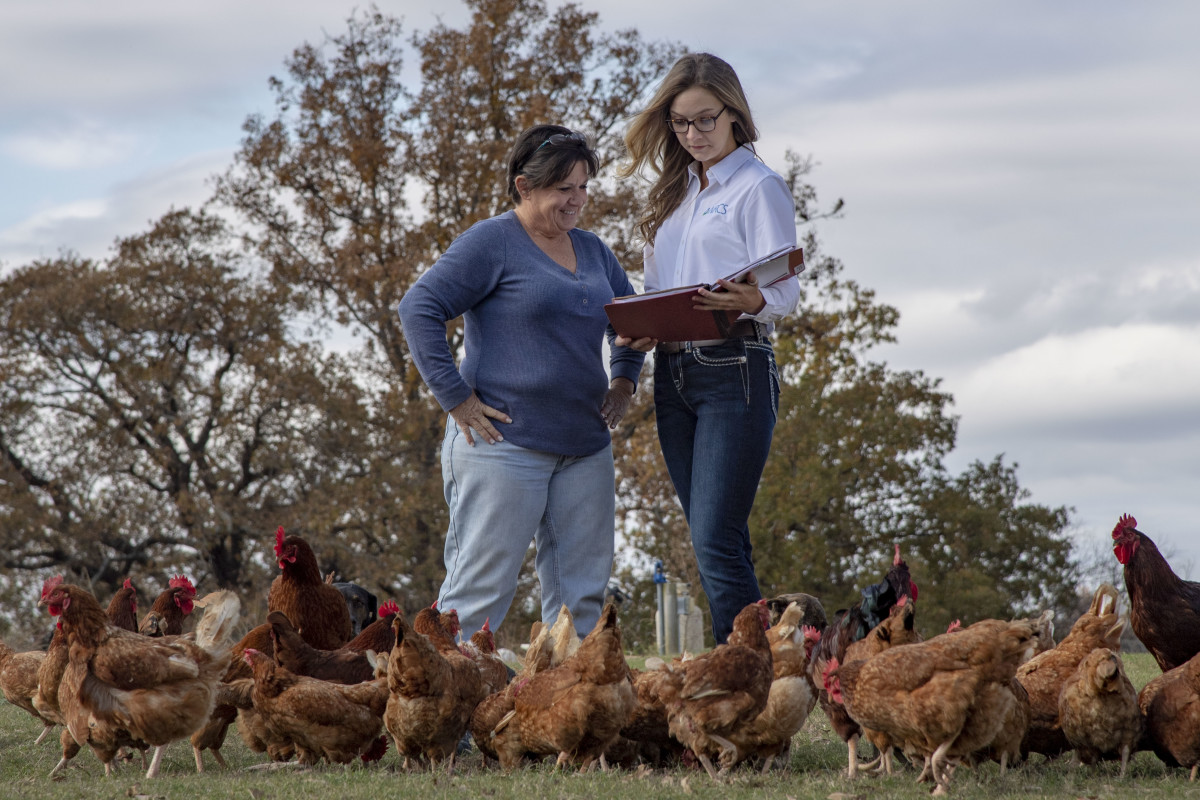 Native American farmer and retired teacher Jerri Parker, pictured with soil conservationist Mary Collier, operates a farm in Cromwell, Oklahoma.