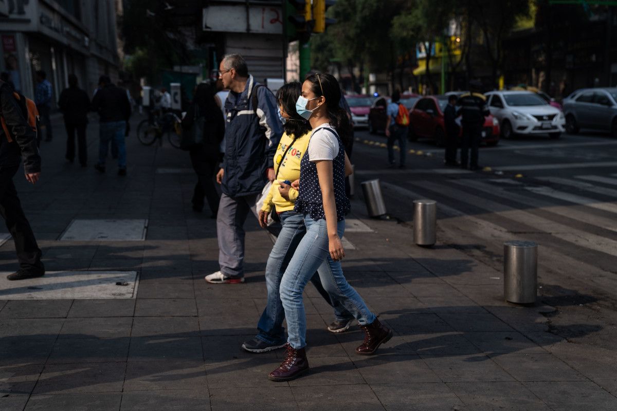 Two women wear face masks on May 16th, 2019, in Mexico City, Mexico. Mexico City's air pollution has worsened as a consequence of high temperatures, lack of rain, and fires located around the city's valley, where people have been advised to stay indoors and avoid using their vehicles, and schools have been ordered to close.
