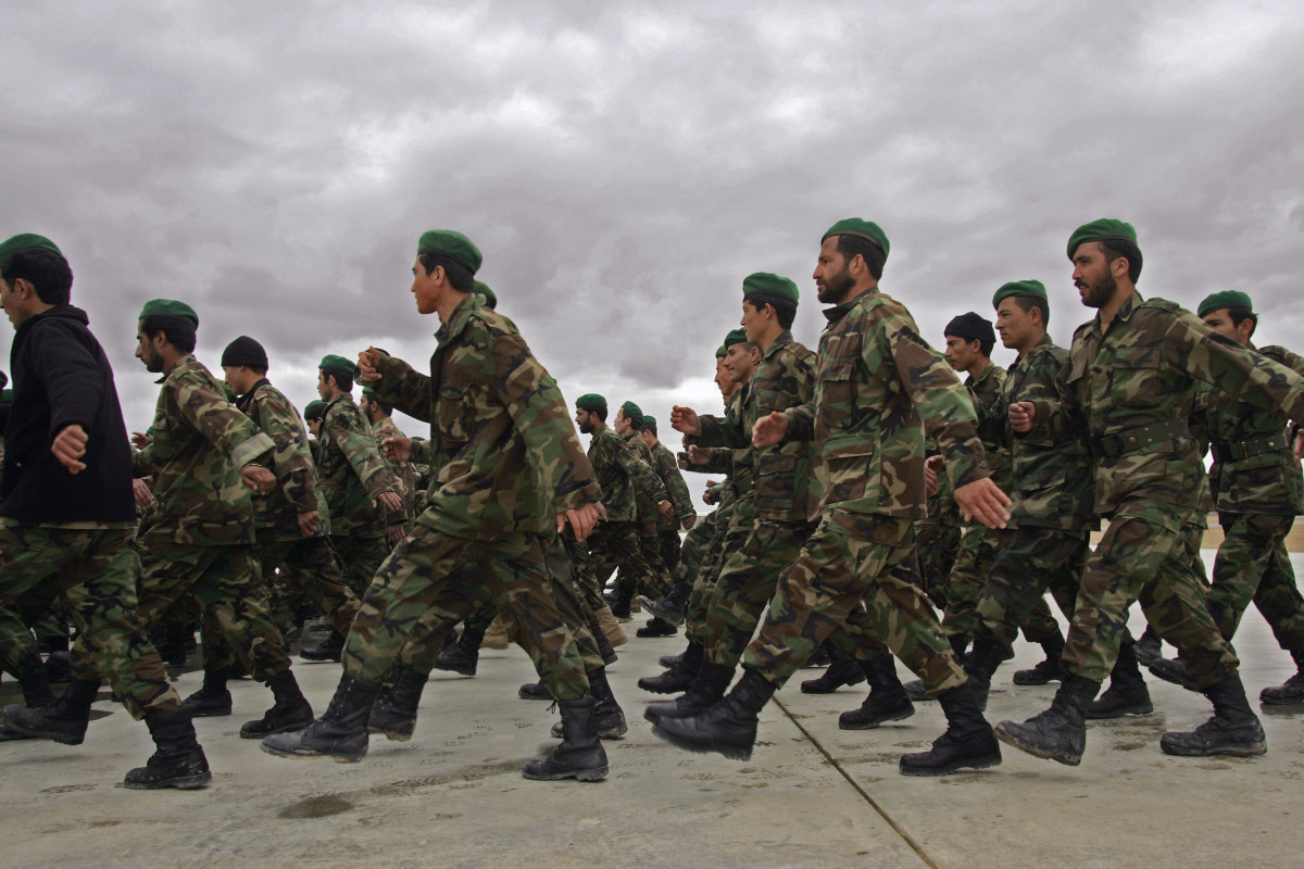 Afghan Army soldiers march to a briefing at Camp Shorabak in Afghanistan's Helmand province.