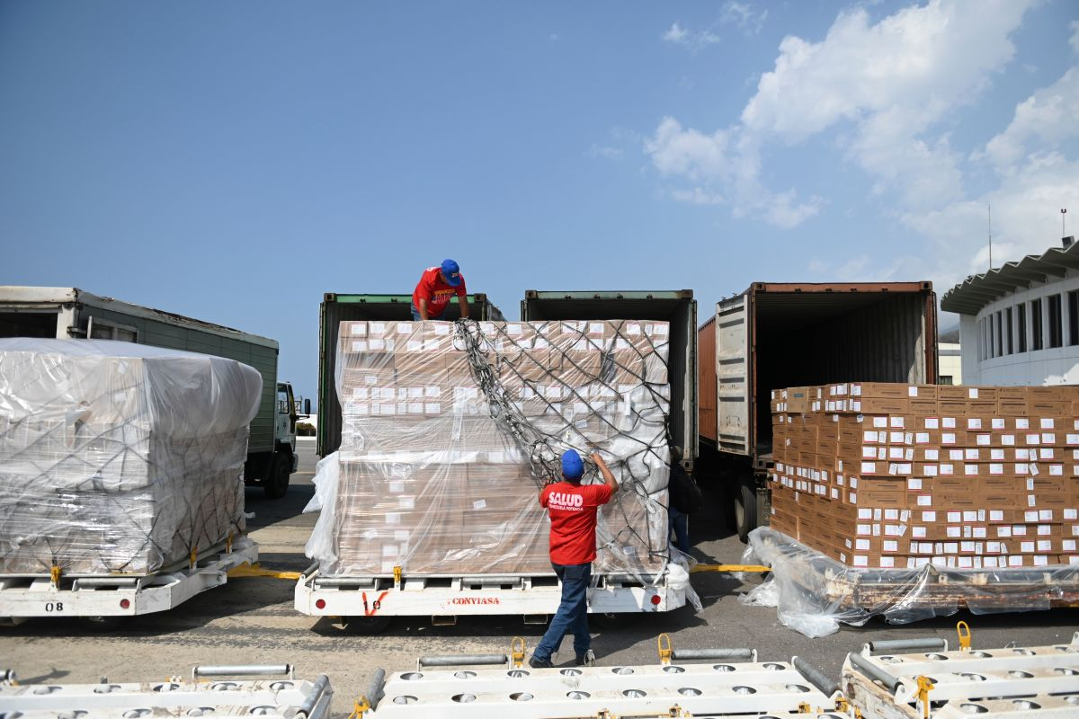 Workers unload medicines and disposable medical supplies from a Chinese Yangtze River Express Airlines Boeing 747 cargo plane after landing at Simon Bolivar International Airport on May 16th, 2019, in Maiquetia, Venezuela.