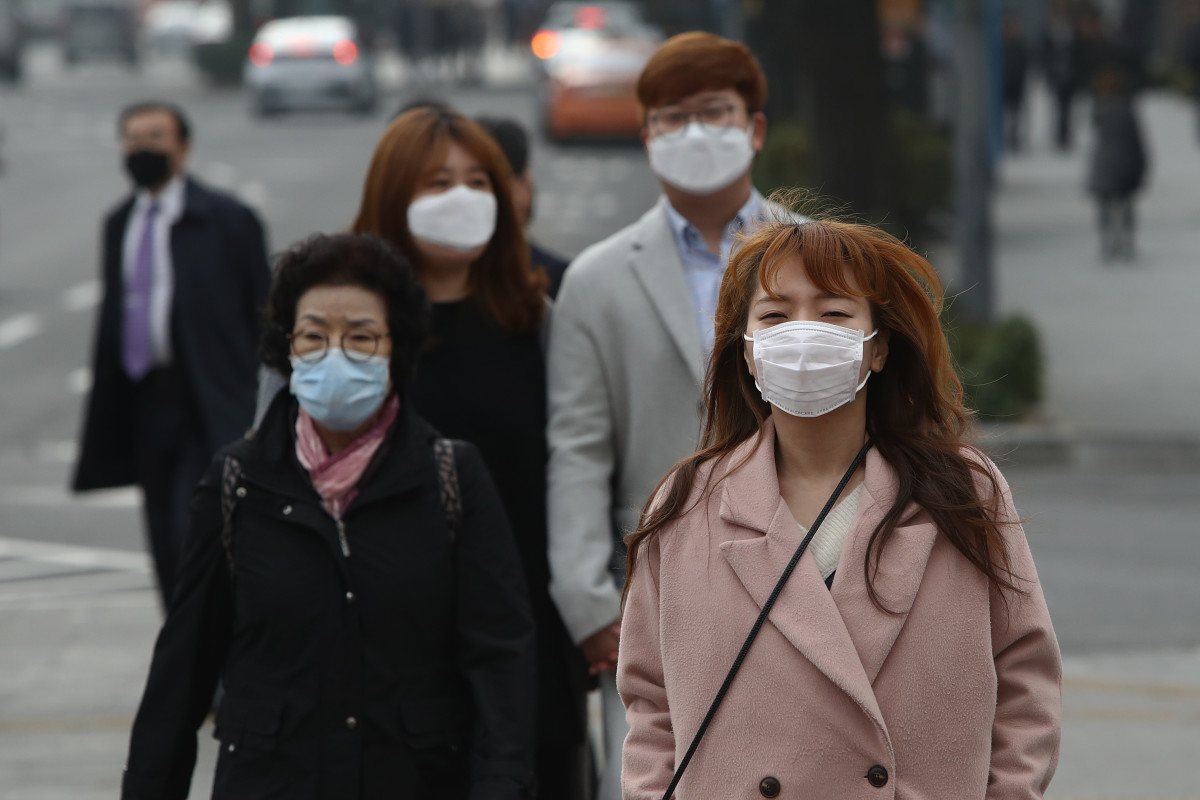 Pedestrians wearing masks walk during a polluted day in Seoul, South Korea.