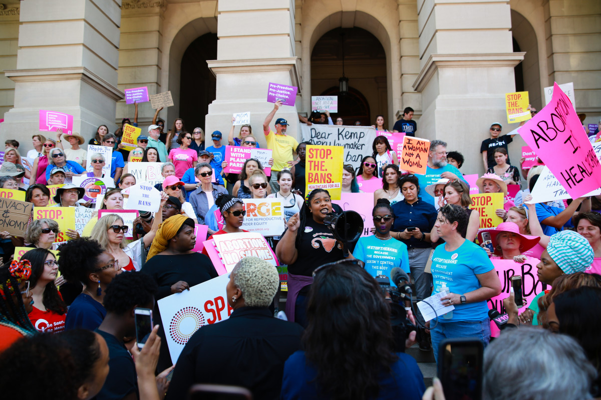 "A woman speaks during a protest against recently passed abortion ban bills at the Georgia State Capitol building, on May 21st, 2019, in Atlanta, Georgia. The Georgia ""heartbeat"" bill would ban abortion when a fetal heartbeat is detected. The Alabama abortion law, signed by Governor Kay Ivey last week, includes no exceptions for cases of rape and incest, outlawing all abortions except when necessary to prevent serious health problems for the pregnant person. The new law also punishes doctors for performing an abortion, making the procedure a felony punishable by up to 99 years in prison."