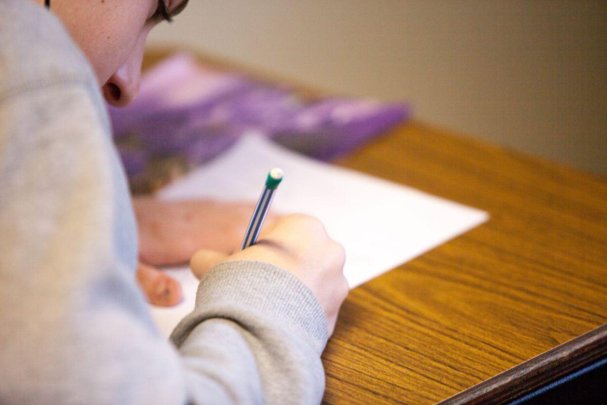 Woman girl taking standardized test school classroom