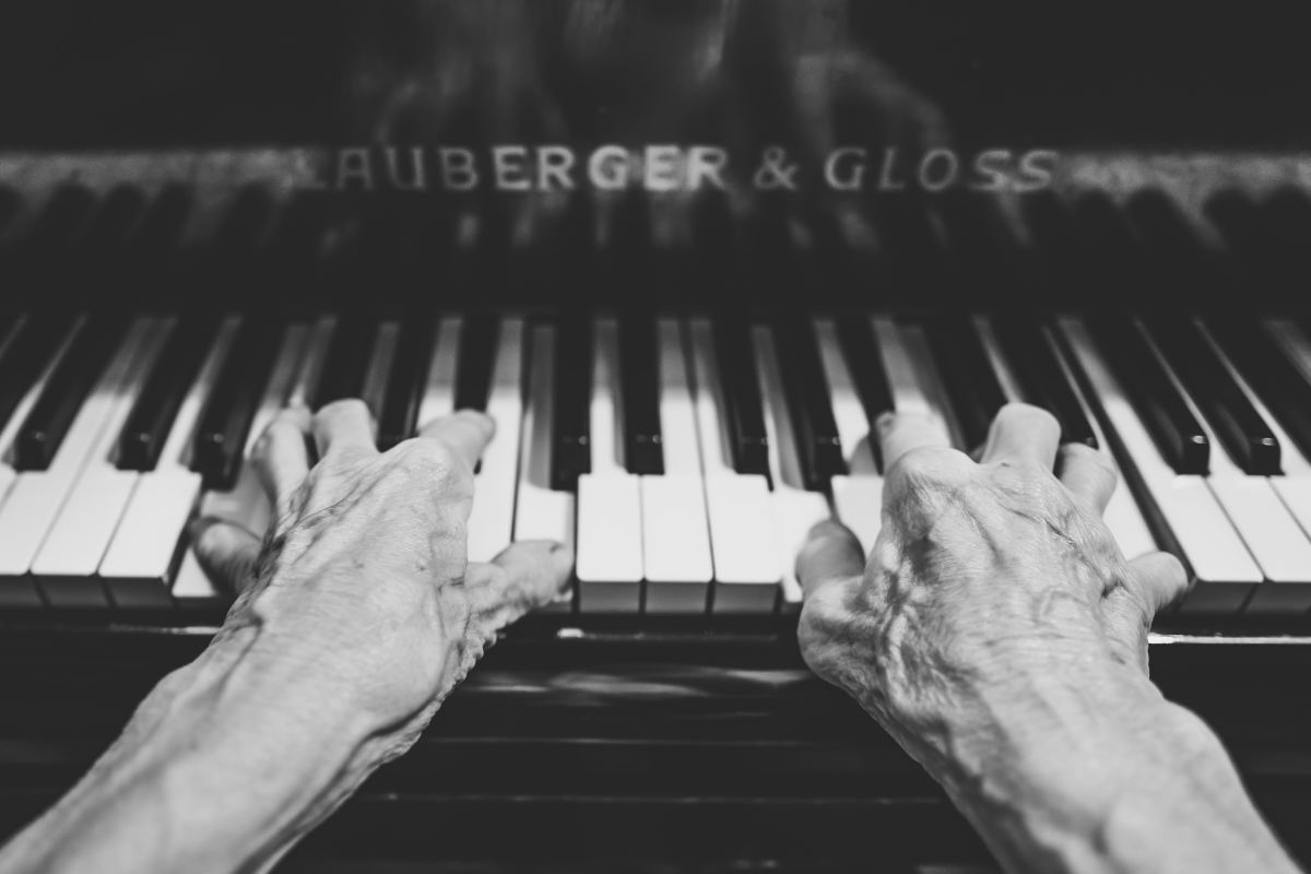 Elderly old people hands piano keyboard