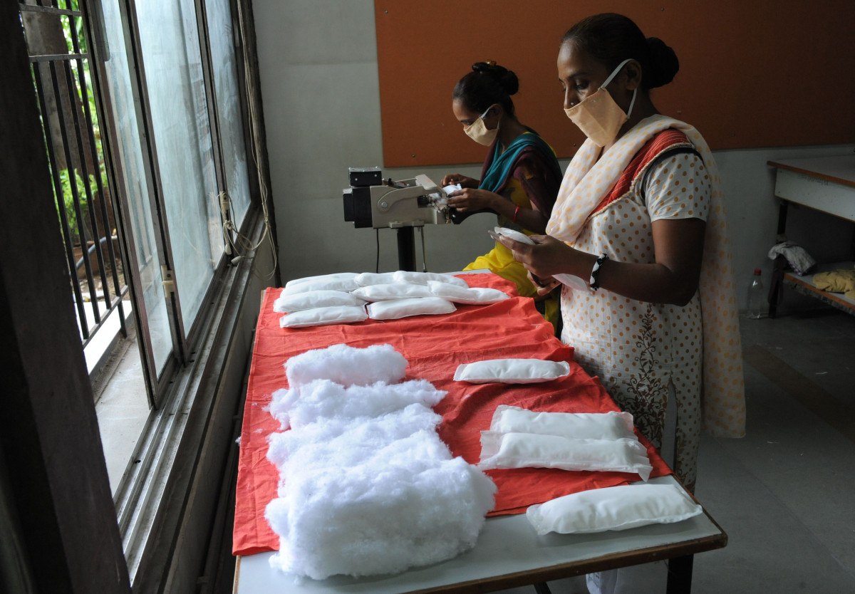 Members of the Self Employed Women's Association (SEWA) make low-cost sanitary pads at their facility in Ahmedabad, India, on September 3rd, 2012. Prompted by the widespread suffering of women and girls in rural areas who continue to be plagued by unhygienic old cloth pieces or rags during their menstrual cycle periods, SEWA is manufacturing low-cost sanitary pads with a production capacity at 2,000 pads per day.