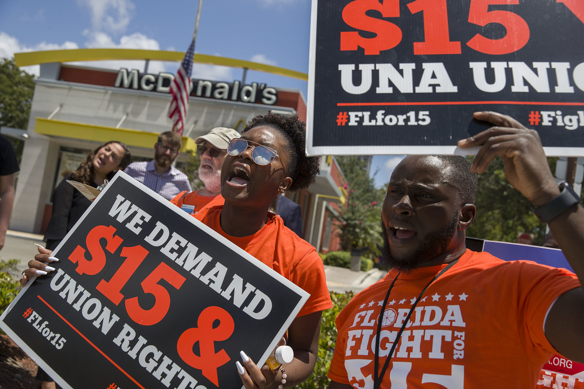 People gather to ask the McDonald's corporation to raise workers' wages to a $15 minimum wage as well as demand the right to a union on May 23rd, 2019, in Fort Lauderdale, Florida. The nationwide protest was held on the day of the company's shareholder meeting.