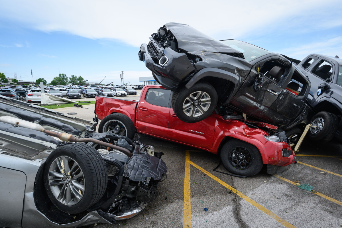 Trucks are piled on top of each other at Riley Auto Group on May 23rd, 2019, in Jefferson City, Missouri, after a tornado struck there.