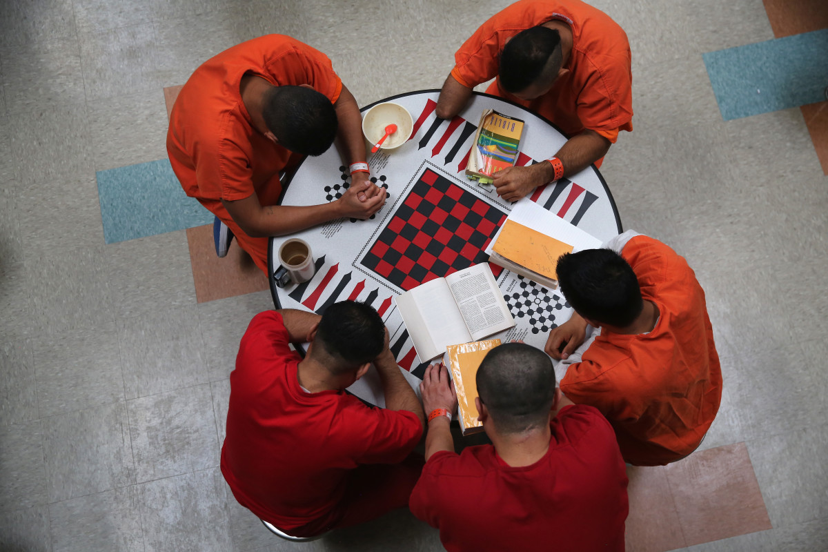 Immigrant detainees at the Adelanto Detention Facility engage in prayer.