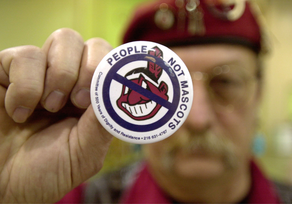 A man protests using Native Americans as mascots for sports teams at the 10th Annual New Years Eve Sobriety Powwow in 2003.