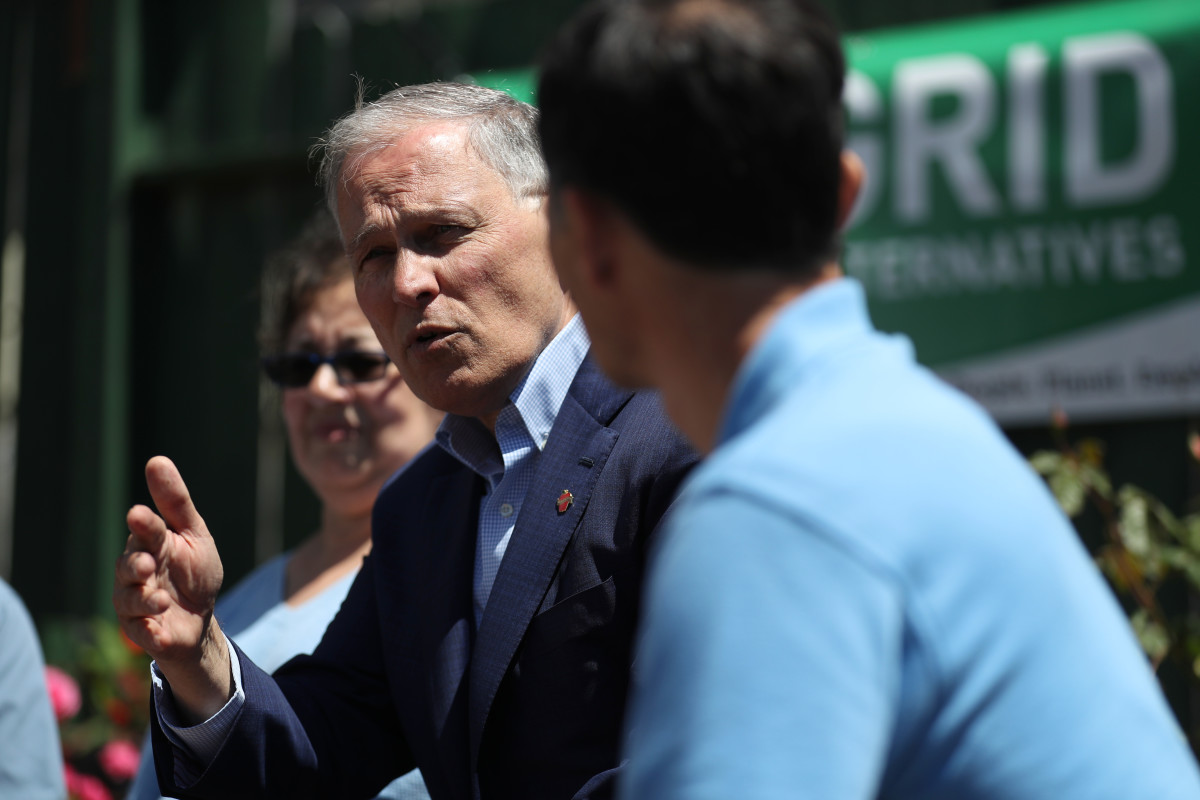 Democratic presidential candidate Washington Governor Jay Inslee talks with solar workers and homeowners about recent solar panel installations on their homes on May 2nd, 2019, in San Francisco, California.