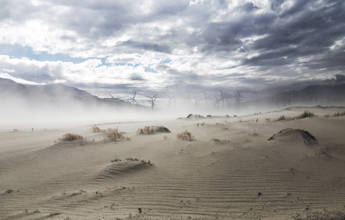 Strong winds blow sand at a wind farm in the Coachella Valley on May 6th, 2019, in Palm Springs, California. California's Fourth Climate Change Assessment found that temperatures of the inland deserts of Southern California, including the Coachella Valley, are expected to continue climbing. According to the report, average daily highs could increase as much as 14 degrees this century if greenhouse gas emissions keep rising.