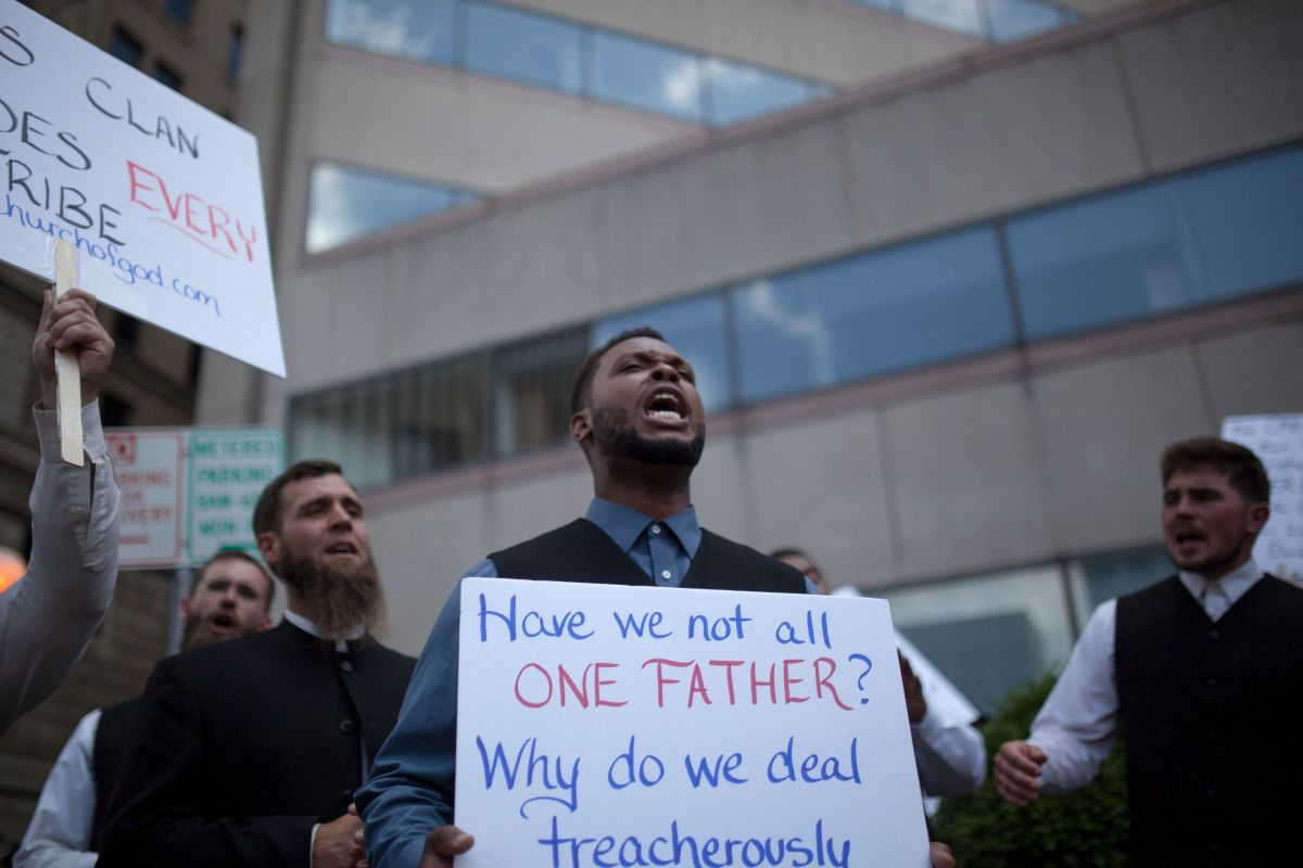 A religious counter-protester group sings church hymns during a demonstration against the rally by a small group from the KKK-affiliated Honorable Sacred Knights in Dayton, Ohio, on May 25th, 2019.