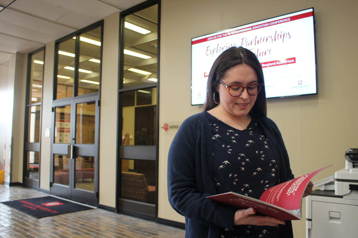 Ruby Ortiz flips through a brochure in Hawthorn Hall.