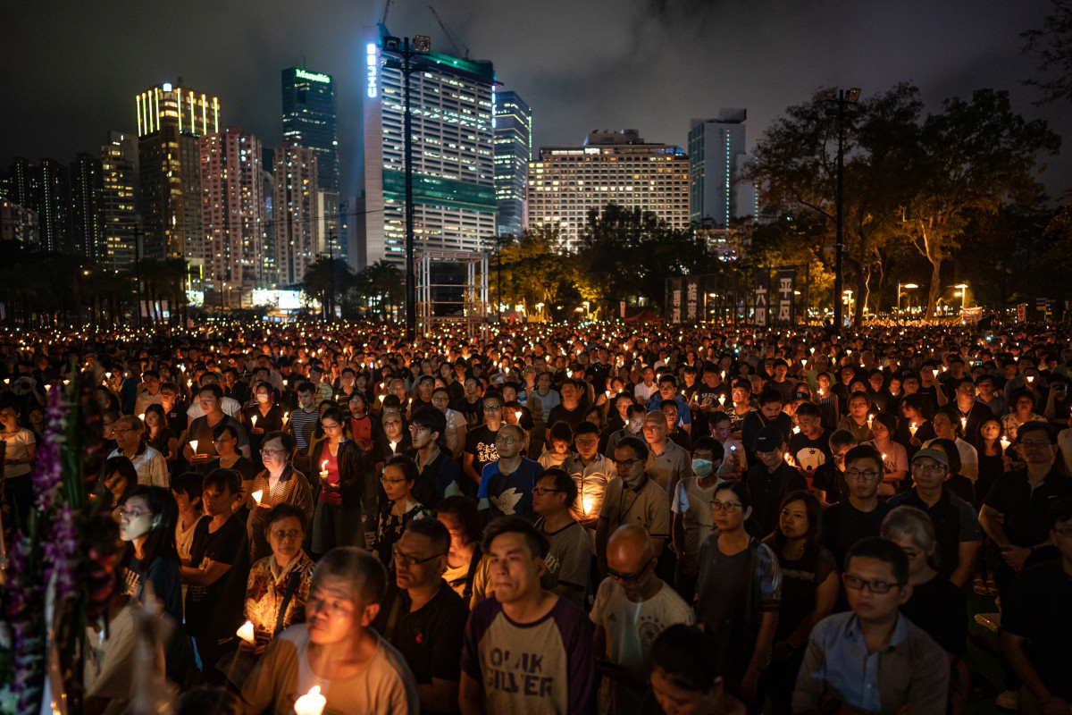 People hold candles as they take part in a candlelight vigil at Victoria Park on June 4th, 2019, in Hong Kong, China. As many as 180,000 people were expected to attend a candlelight vigil in Hong Kong on Tuesday during the 30th anniversary of the Tiananmen Square massacre. Commemorations took place in cities around the world to remember those who died when Chinese troops cracked down on pro-democracy protesters. Thirty years ago, the People's Liberation Army opened fire on protesters in Beijing after hundreds of thousands of students and workers gathered in Tiananmen Square for weeks to call for greater political freedom. No one knows for sure how many people were killed, as China continues to censor any coverage or discussion of the event.