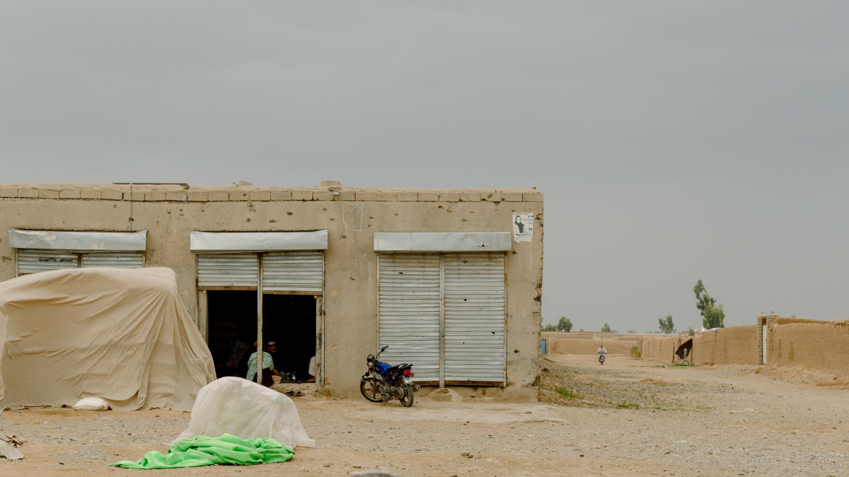 Buildings damaged by fierce fighting are seen in April of 2019 next to the road connecting Nad Ali and Lashkar Gah, the capital of Helmand Province. Most of the bullet holes are a reminder of 2016, when the Taliban pushed government forces back to Lashkar Gah, where they were surrounded until U.S. airstrikes helped the Afghan forces retake some territory.