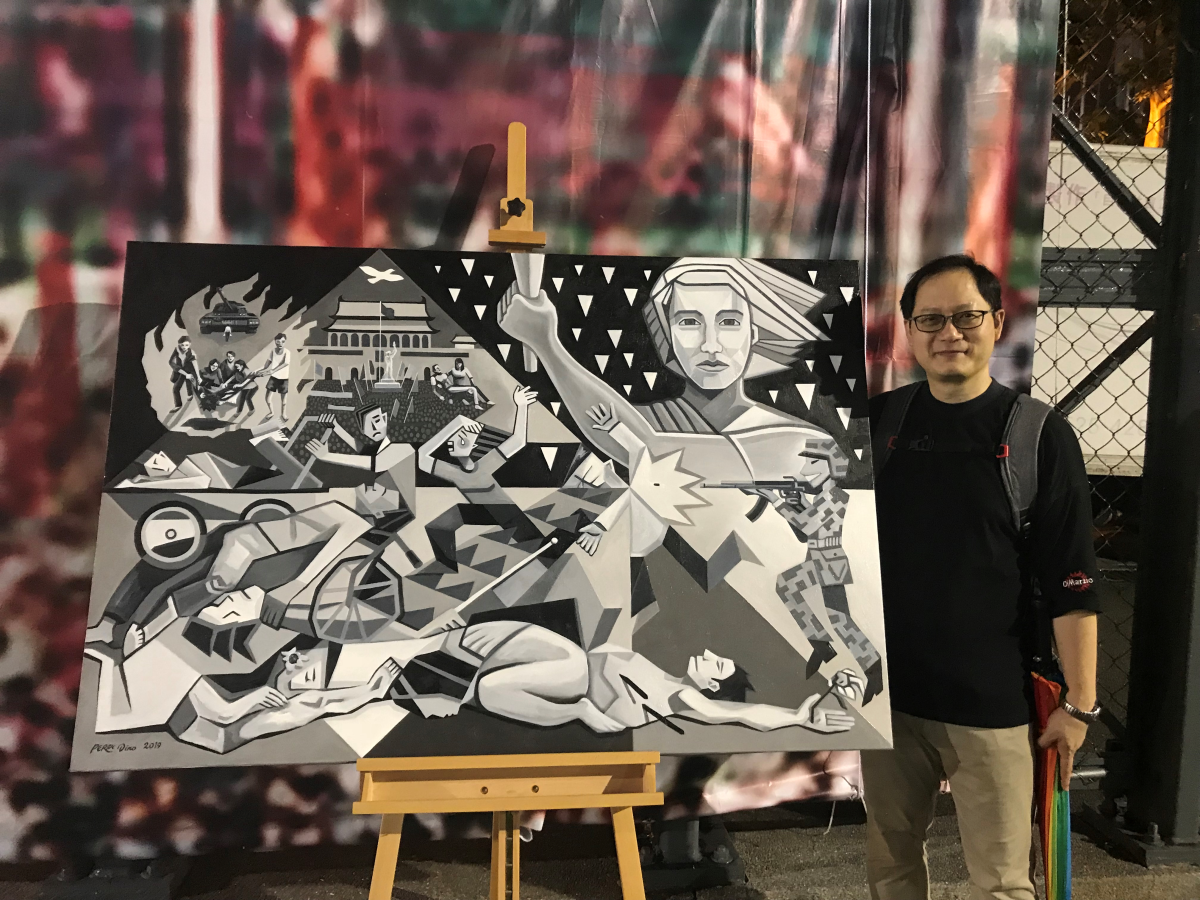 Perry Dino stands beside his painting, 89 64 30, in honor of the Tiananmen 30th anniversary on June 4th, 2019.
