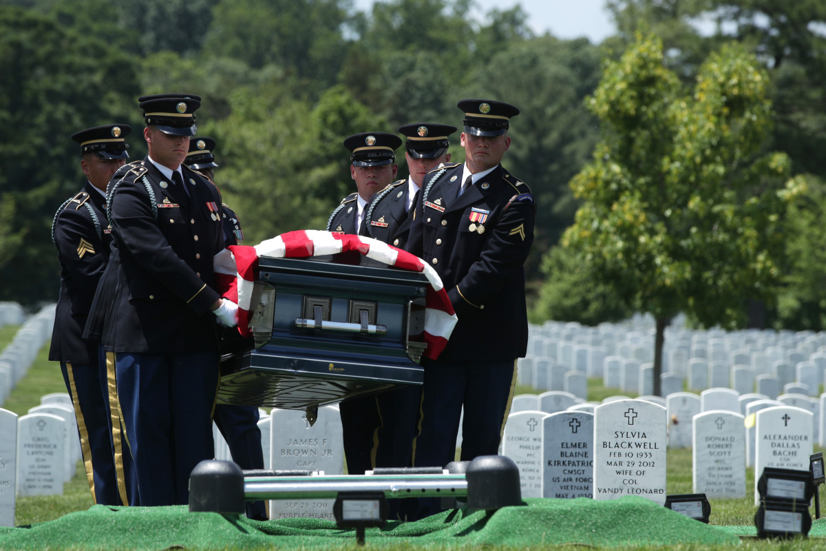 "Members of the United States Army's 3rd Infantry Regiment, ""The Old Guard,"" carry the flag-draped casket of World War II Army veteran Carl Mann to his final resting place during his funeral on the 75th anniversary of the D-Day invasion on June 6th, 2019, at Arlington National Cemetery in Arlington, Virginia. Mann, a native of Indiana, was among the troops who stormed Omaha Beach on D-Day during the amphibious landings at Normandy, France. He was awarded with seven Bronze Stars and three Purple Hearts throughout his years of military service."