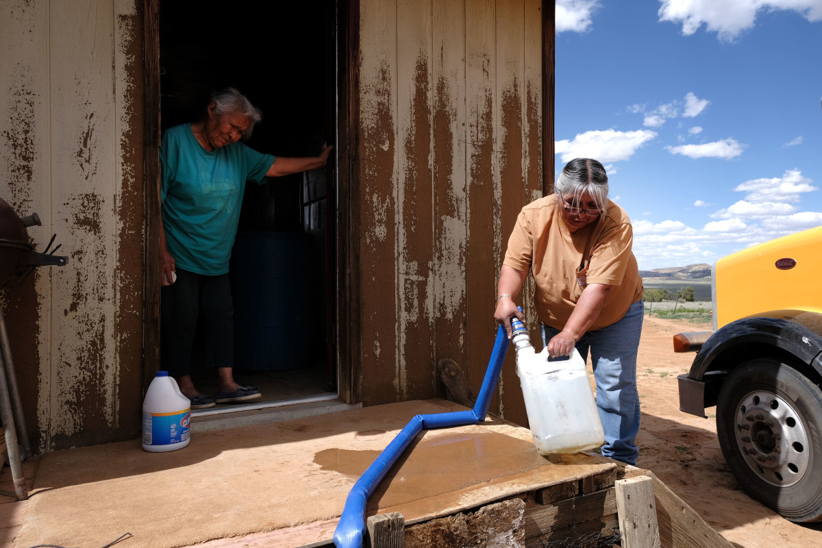 Nancy Bitsue, a member of the Navajo Nation, receives her monthly water delivery in the town of Thoreau on June 6th, 2019. The water shortage in the Navajo Nation, the largest federally recognized sovereign tribe in the U.S., with a population of over 200,000, is so significant that generations of families have never experienced indoor plumbing.