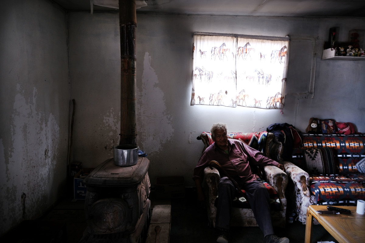 An elderly member of the Navajo Nation waits in his home for his monthly water delivery in the town of Thoreau on June 6th, 2019.
