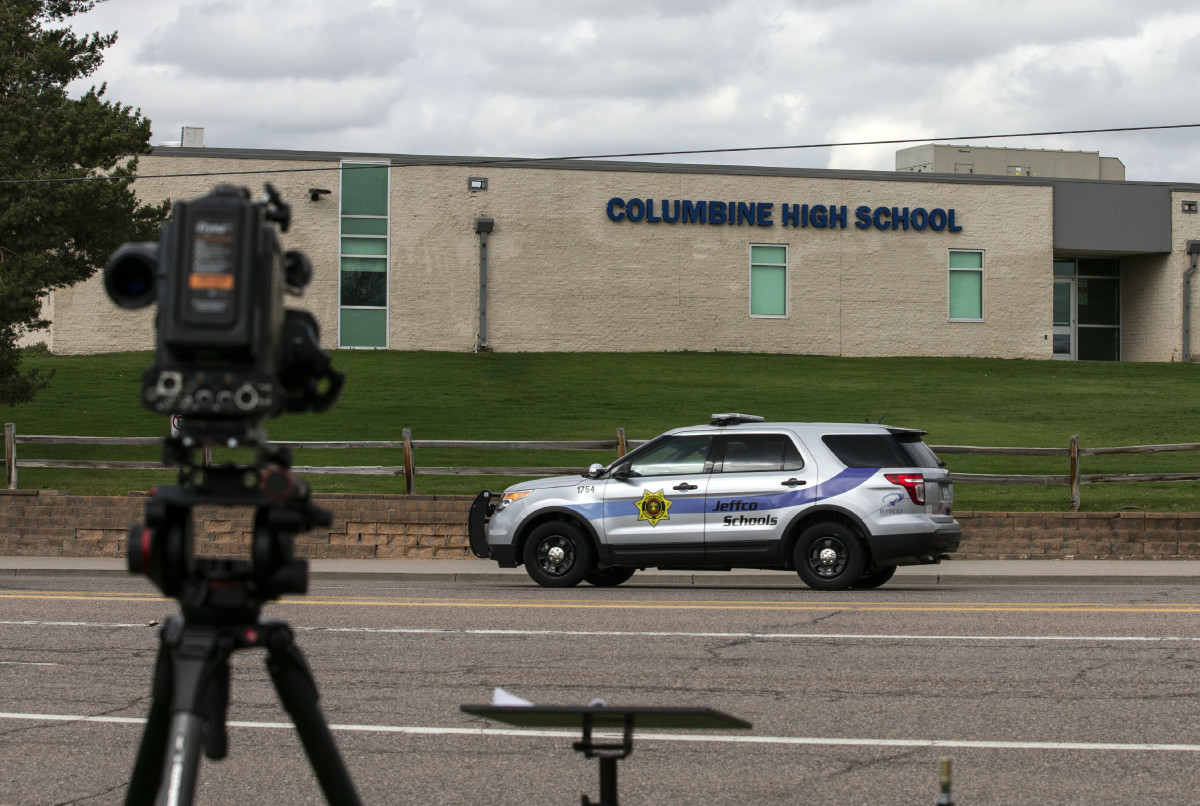 Police patrol outside Columbine High School on April 17th, 2019, in Littleton, Colorado, as all Denver-area schools were evacuated and classes canceled after an active threat to the area.