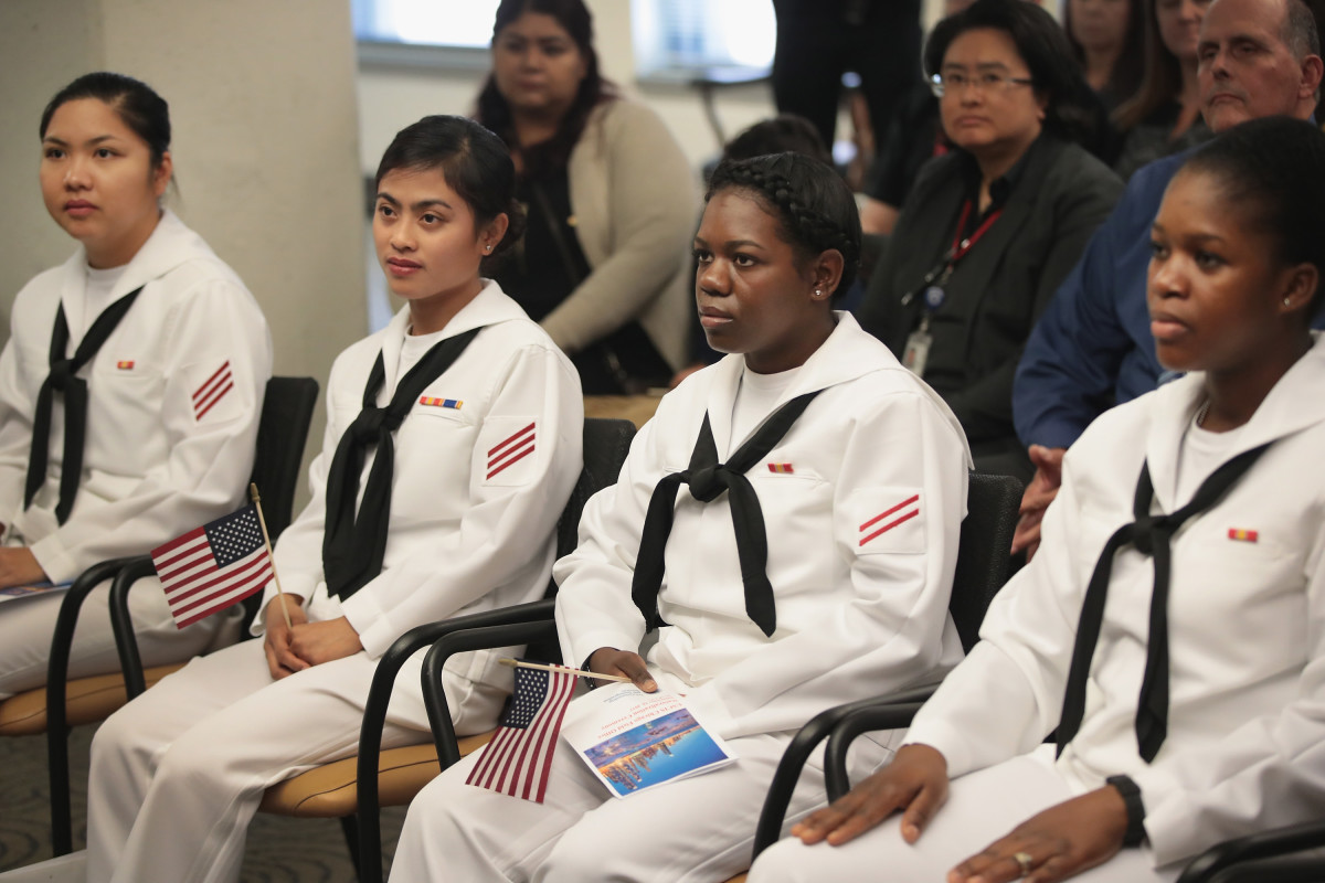 Sailors, serving in the U.S. Navy at Naval Station Great Lakes, are sworn in as U.S. Citizens during a ceremony on September 15th, 2017, in Chicago, Illinois.