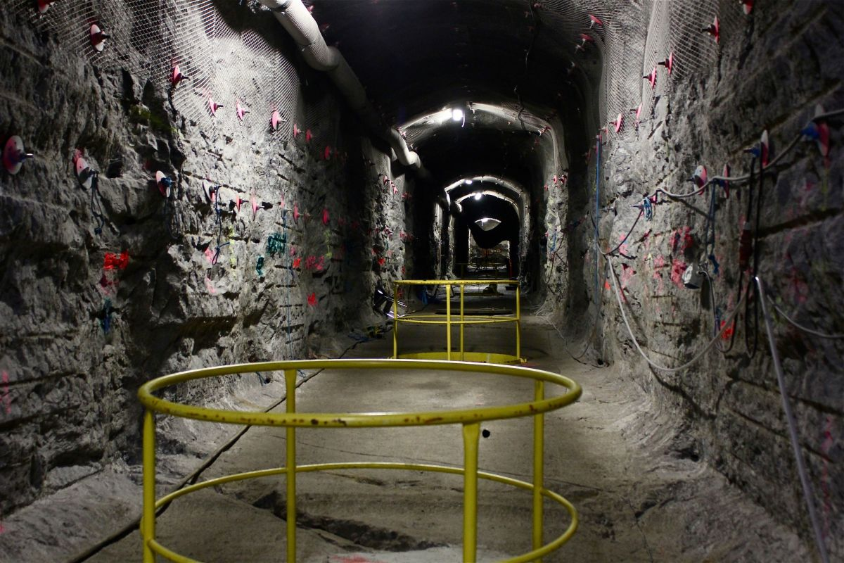 Inside the world's first underground repository for highly radioactive nuclear waste, guardrails surround cylindrical burial holes awaiting their lethal deposits.