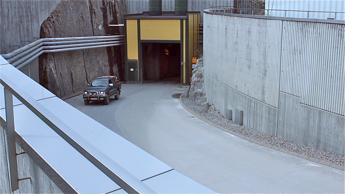 The entrance to Onkalo slopes down into the Earth. When full with waste from the three nearby power stations of Olkiluoto, the storage facility will hold 6,500 tons of spent uranium.