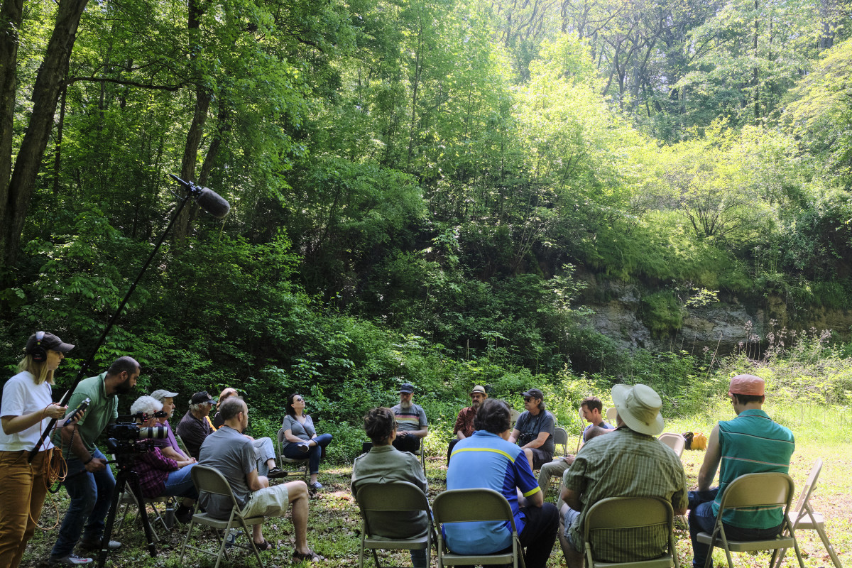 A film crew from A Blade of Grass documents a Forest Listening Room at Robinson's Cave in Wayne National Forest in May.