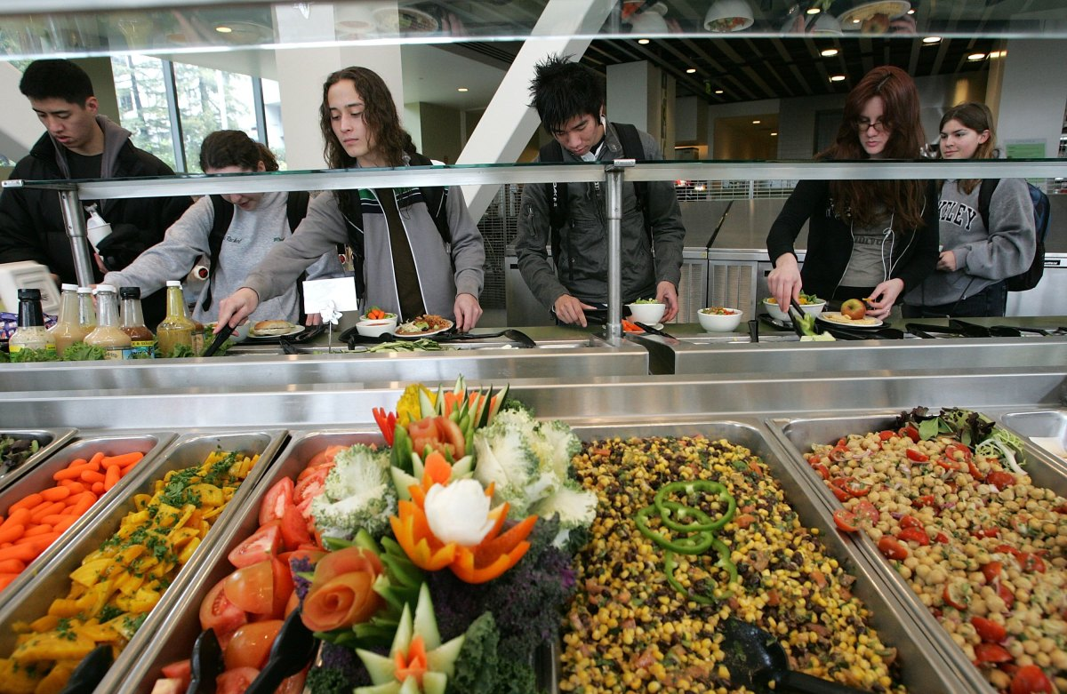 Students at the University of California–Berkeley build salads with organic vegetables at Crossroads dining commons.