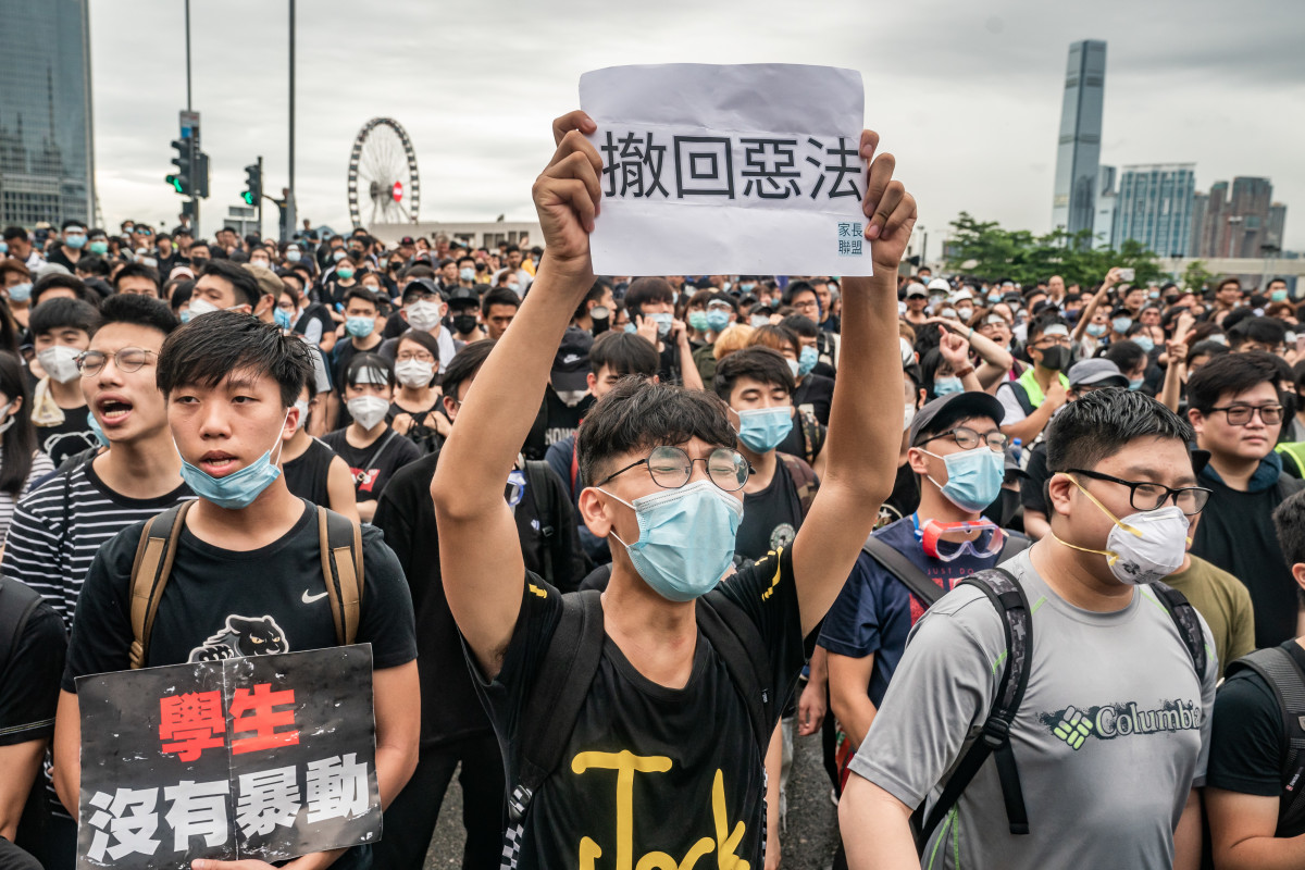 Protesters hold placards and shout slogans as they occupy a street demanding that Hong Kong Chief Executive Carrie Lam step down, after a rally against the now-suspended extradition bill outside of the chief executive office on June 17th, 2019, in Hong Kong, China. The controversial bill would allow Hong Kong citizens suspected of crimes to be extradited to mainland China.