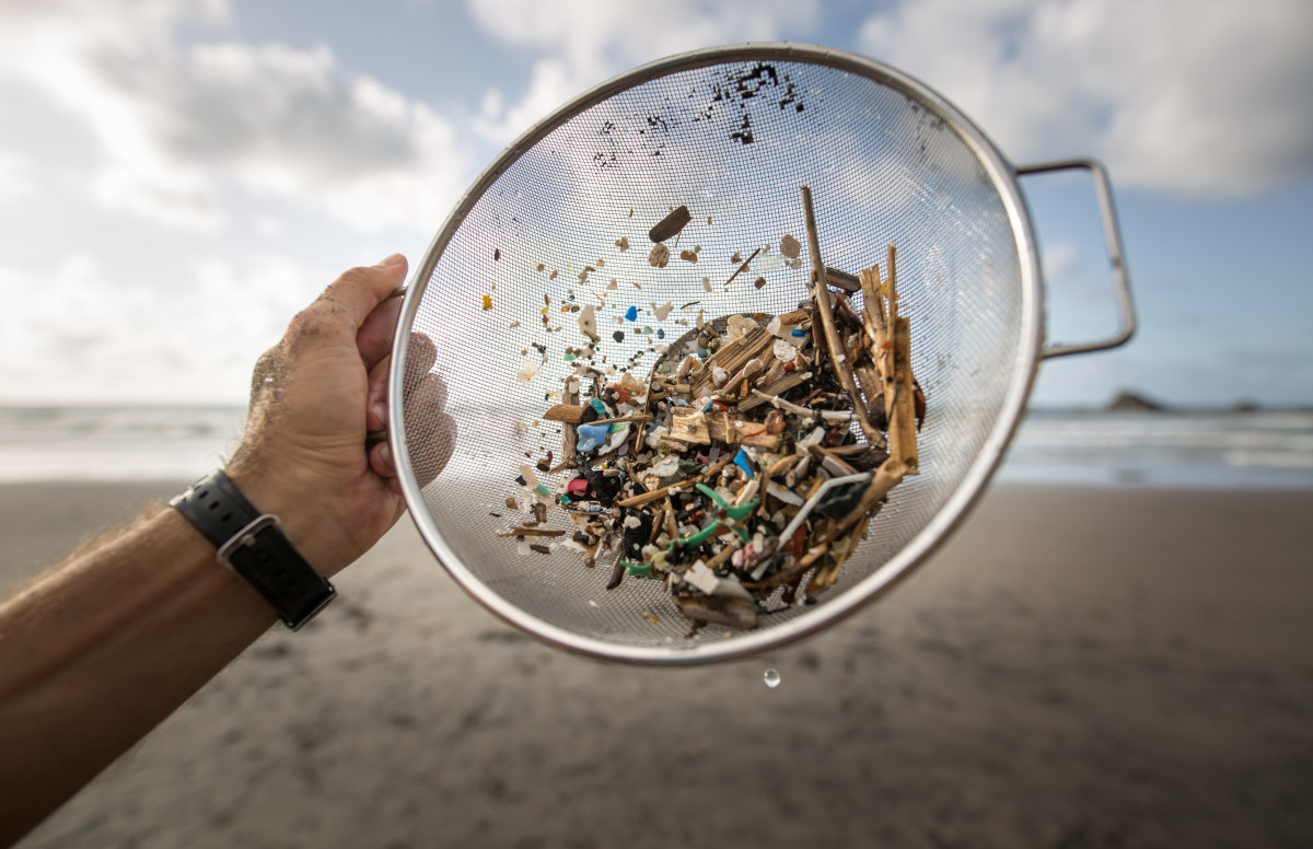 A volunteer of the non-governmental organization Canarias Libre de Plasticos carries out a collection of microplastics and mesoplastic debris to clean the Almaciga Beach, on the north coast of the Canary Island of Tenerife, on July 14th, 2018.