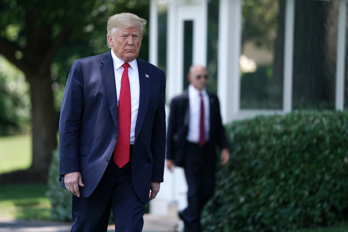 President Donald Trump walks to reporters before leaving the White House for the G20 summit on June 26th, 2019.