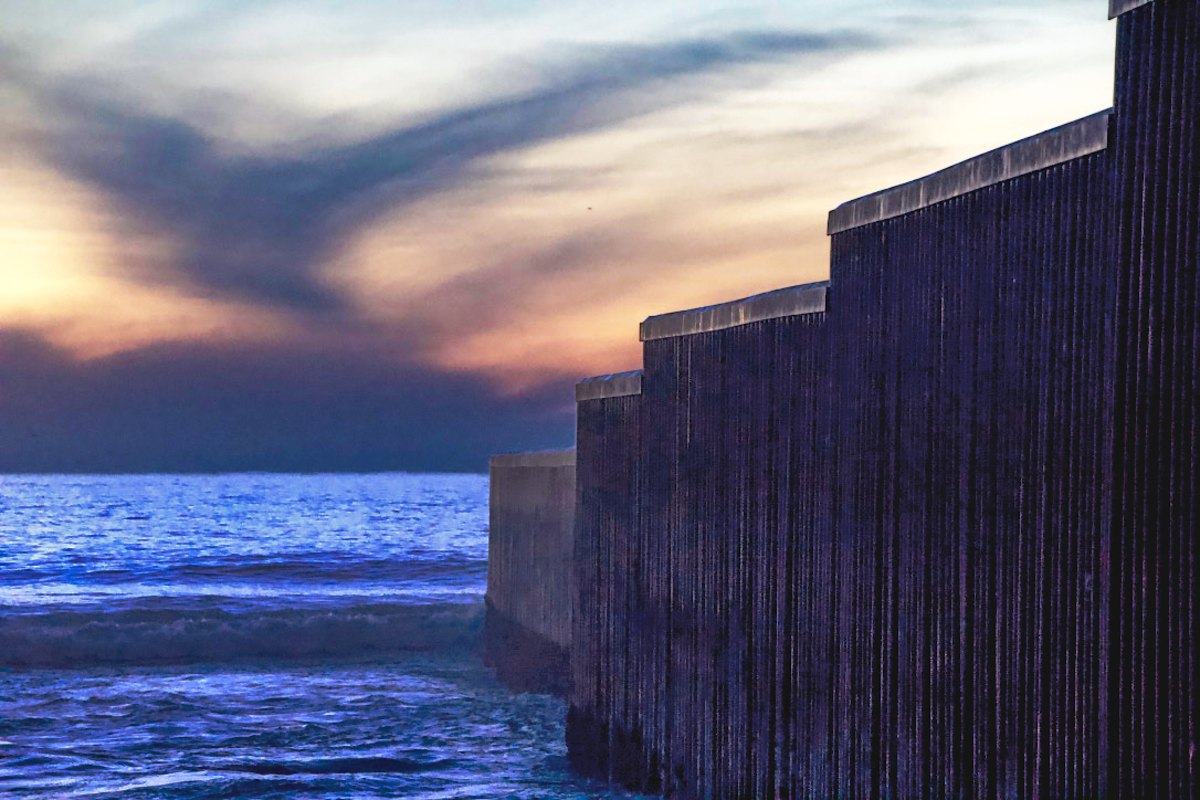 The border wall extends into the Pacific between Mexico and the United States.
