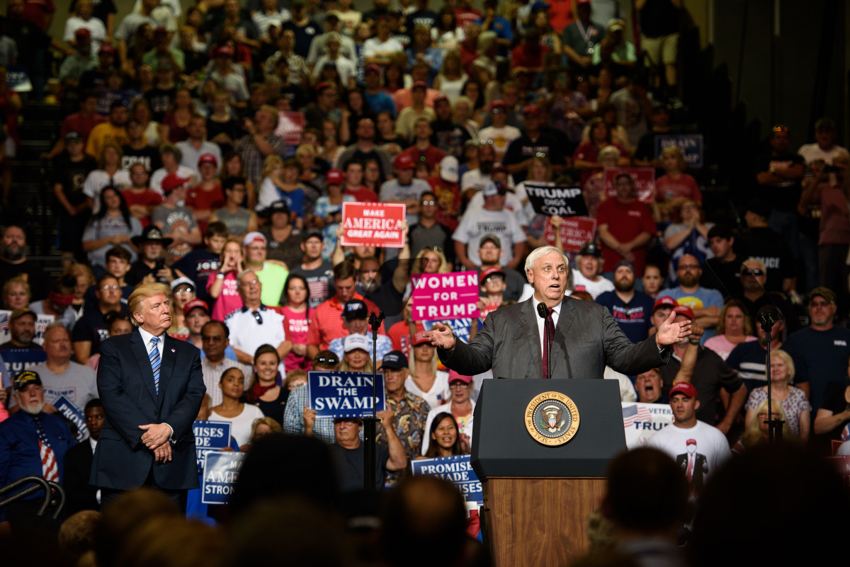 West Virginia Governor Jim Justice announces that he is switching parties to become a republican as President Donald J. Trump listens on at a campaign rally at the Big Sandy Superstore Arena on August 3rd, 2017, in Huntington, West Virginia.