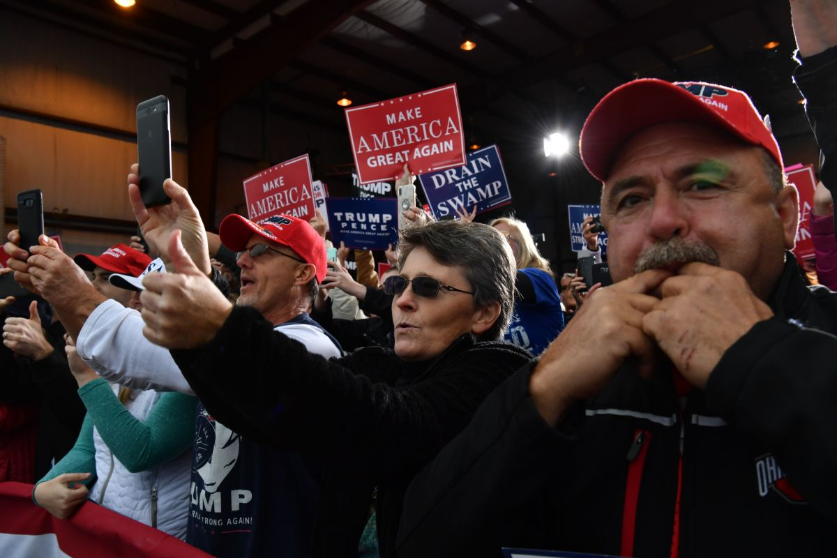 People cheer as President Donald Trump arrives to speak at a campaign rally at the Huntington Tri-State Airport, on November 2nd, 2018, in Huntington, West Virginia.