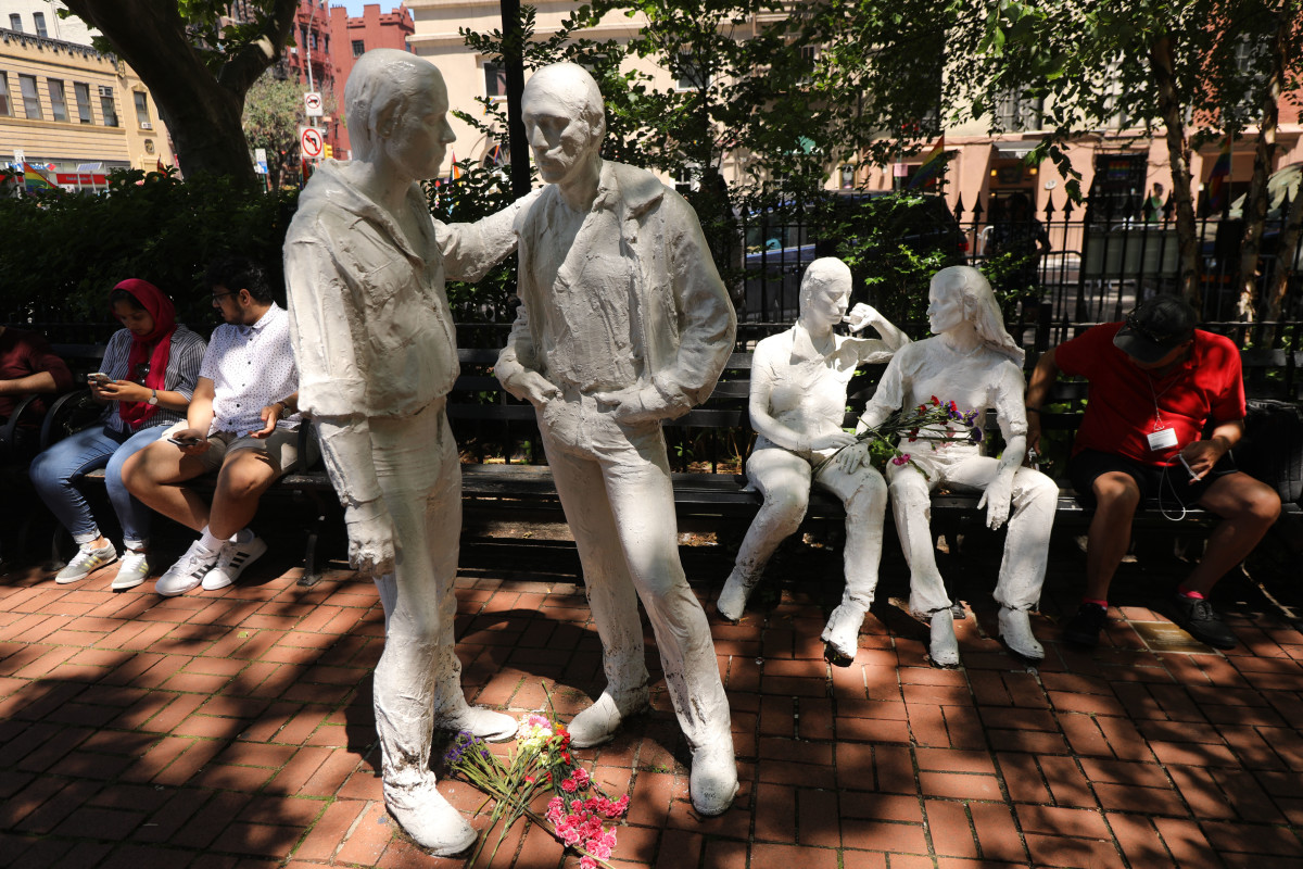 Statues celebrating gay life in New York City stand outside the Stonewall Inn as a crowd gathers to celebrate Pride Month on June 26th, 2019, in New York City.