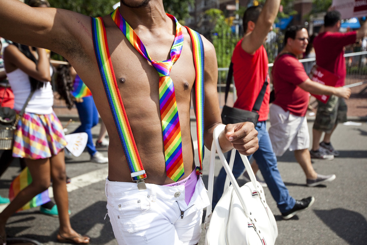 A man wears matching rainbow suspenders and tie during the Gay Pride March on June 24th, 2012, in New York City.