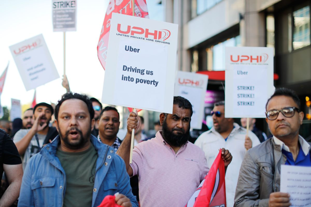 Uber drivers march to Uber's offices in London on October 9th, 2018, with placards and banners from the various trade unions.