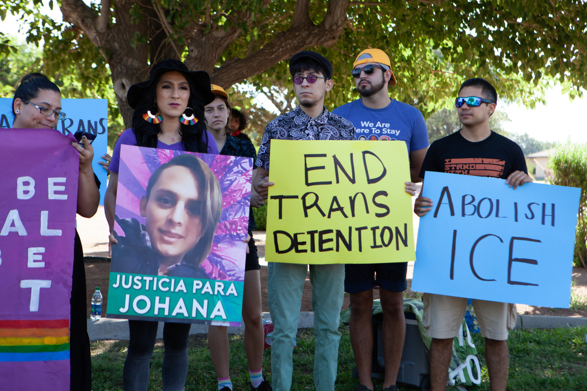 At the march in El Paso on Tuesday, a protester holds a sign bearing the photo of Johana Medina Leon, a trans woman from El Salvador who died in a hospital after falling increasingly ill in an ICE detention center in El Paso.