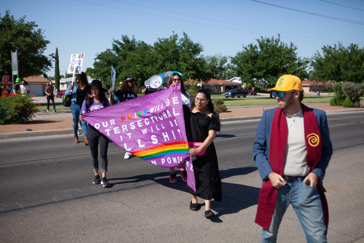 Protesters make their way through El Paso to the El Paso Processing Center, an ICE facility.
