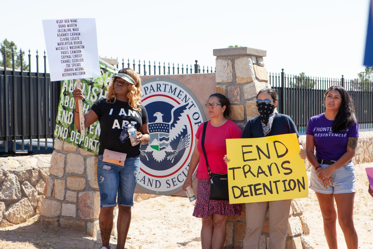 Protesters gather outside the El Paso Processing Center, an ICE facility, near a sign bearing the insignia of the Department of Homeland Security, ICE's parent agency.