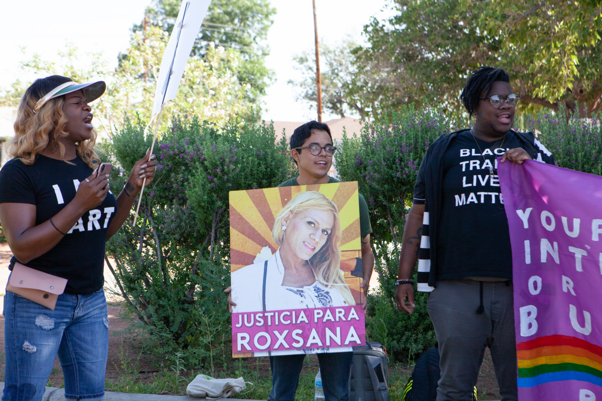 "A protester holds a sign that reads ""Justice for Roxsana"" in Spanish. Roxsana Hernandez Rodriguez was a Honduran asylum seeker who died in ICE custody in 2018."