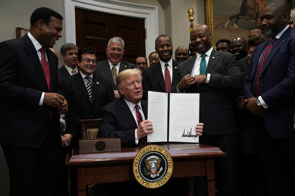 President Donald Trump signs an executive order in December of 2018 to establish the White House Opportunity and Revitalization Council to oversee the opportunity zones program.