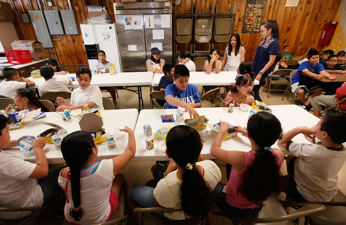 Children eat breakfast at the start of a day camp program at Casa Juan Diego St. Pius V Youth Center on June 24th, 2009, in Chicago. The center provides free breakfast and lunch to about 90 children a day.