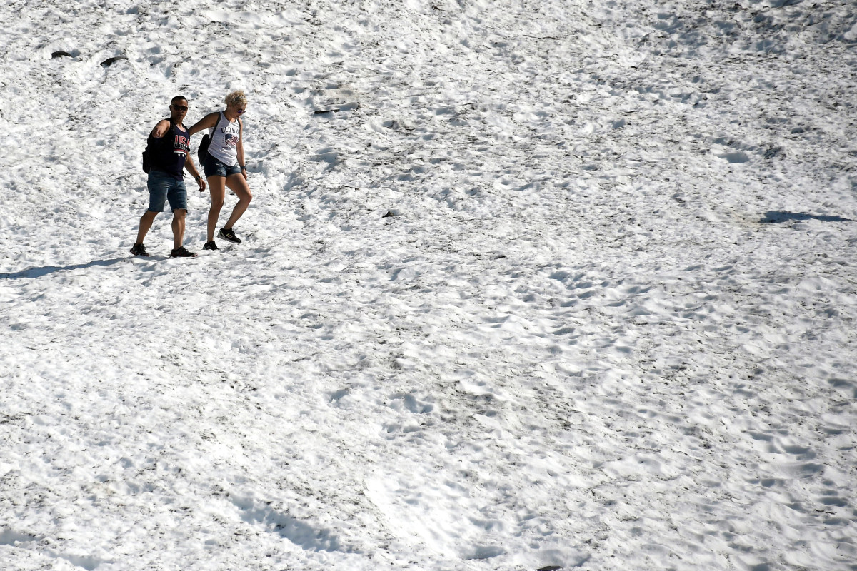 People hike on the Byron Glacier on July 4th, 2019, near Portage Lake in Girdwood, Alaska. Alaska is bracing for record warm temperatures and dry conditions in parts of the state. Anchorage hit a record high of 90 degrees Fahrenheit on July 4th.