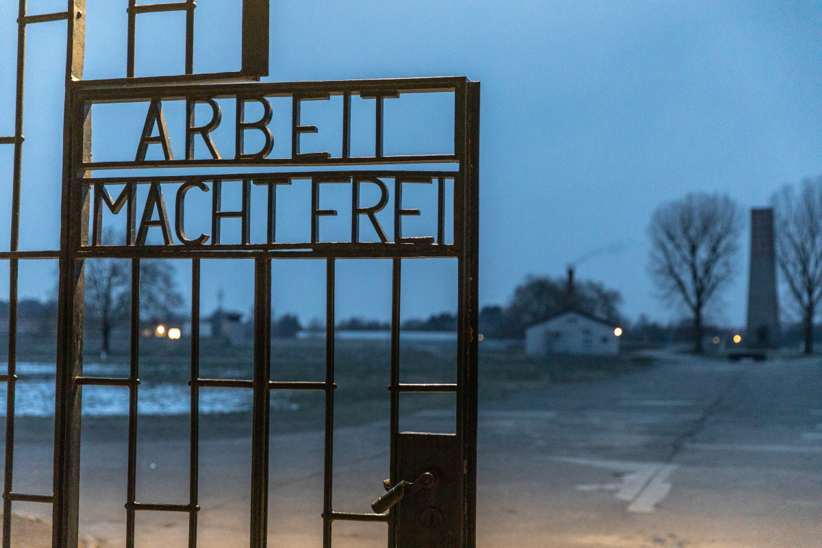 "A gate with the inscription ""Work Sets You Free"" at the Sachsenhausen concentration camp memorial on January 25th, 2019, in Oranienburg, Germany. Starting in 1936, the Sachsenhausen facility was used by the Nazis, initially for political prisoners, then later also for Jews and other religious minorities, homosexuals, and Soviet prisoners of war."