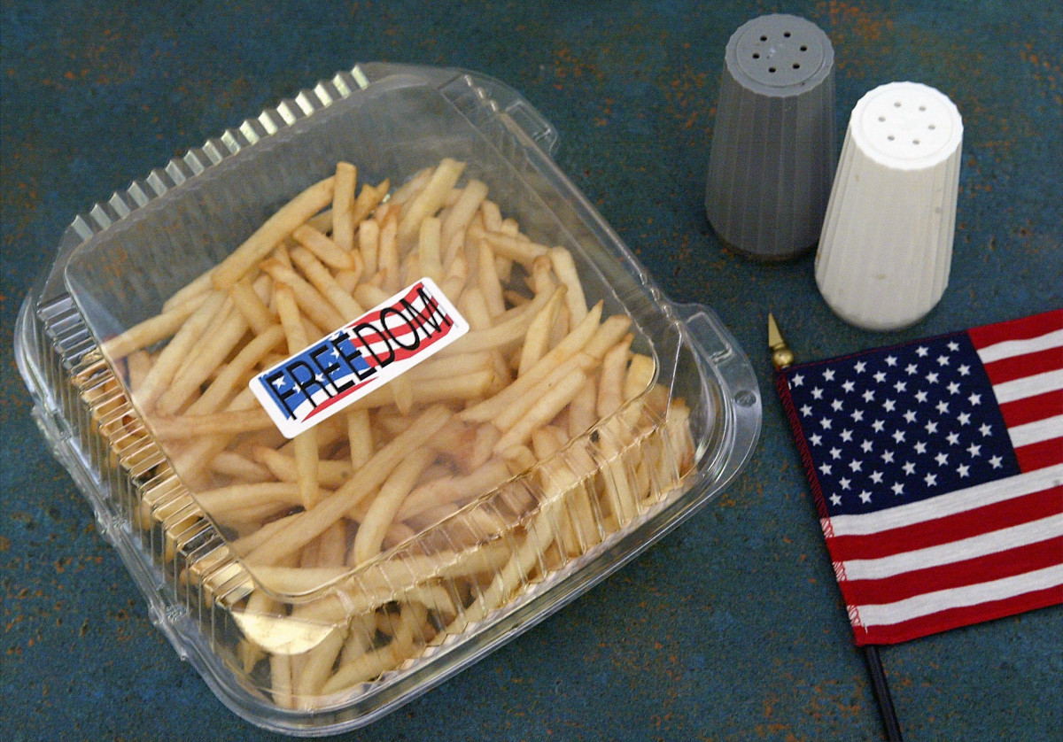 "A box of ""Freedom Fries"" is seen with an American flag at a cafeteria in the U.S. Capitol building on Capitol Hill March 12th, 2003, in Washington, D.C."